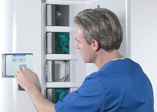White C Folded Scrubs Dispenser